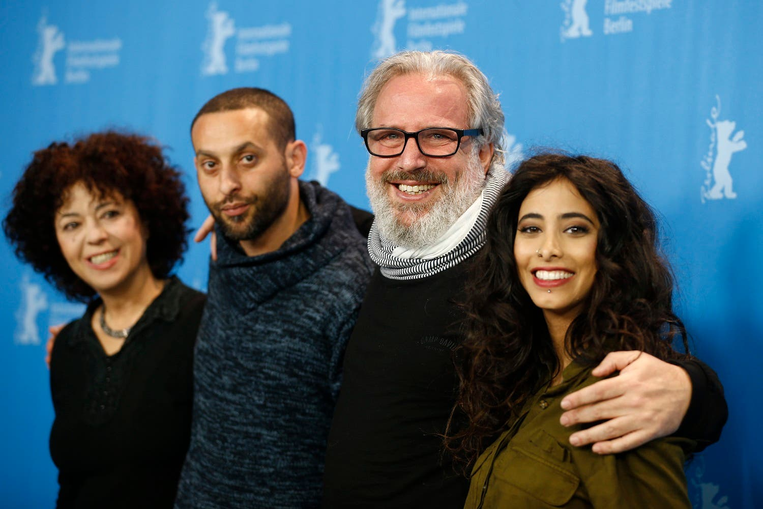 Actress Salwa Sakkara, actor Tamer Nafar, director and producer Udi Aloni and actress Samar Qupty, from left, pose for the photographers during a photo call for the film 'Junction 48' at the 2016 Berlinale Film Festival in Berlin, Germany, Saturday, Feb. 13, 2016. AP