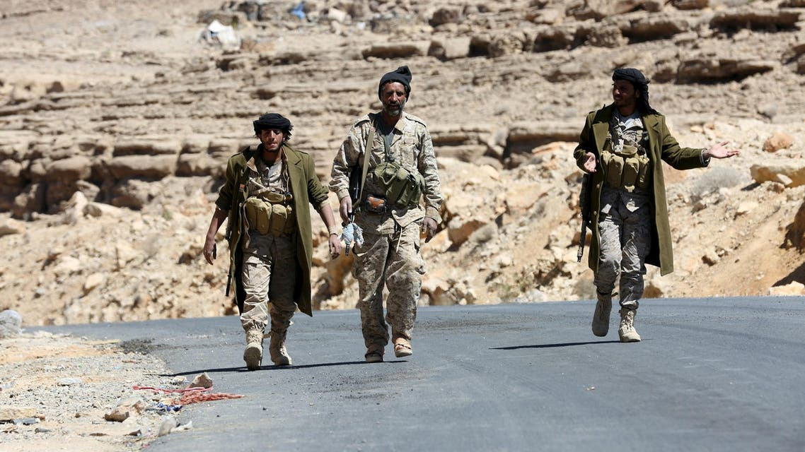 Pro-government army soldiers walk on a road in Fardhat Nahm area, which has recently been taken by the army from Houthi rebels, around 60km (40 miles) from Yemen's capital Sanaa, February 20, 2016. REUTERS