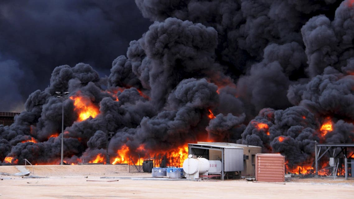 Smoke rises from burning oil storage tanks in the port of Ras Lanuf, Libya, January 23, 2016. REUTERS/Stringer