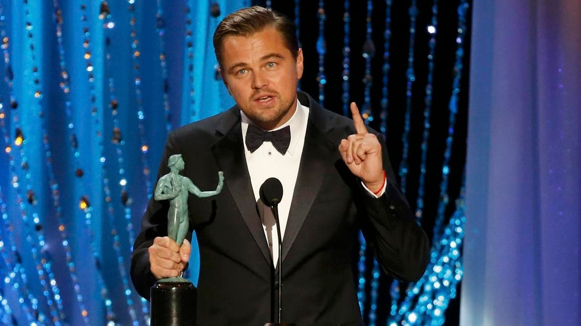 """Leonardo Dicaprio accepts the award for Outstanding Performance by a Male Actor in a Leading Role for his role in """"The Revenant"""" at the 22nd Screen Actors Guild Awards in Los Angeles. (Reuters)"""