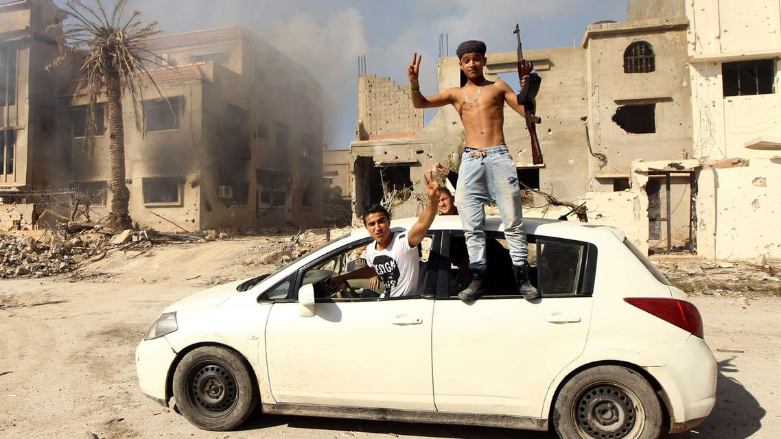Fighters loyal to Libya's internationally recognised government celebrate as they come close to seizing the centre of the eastern coastal city on February 23, 2016. (AFP)