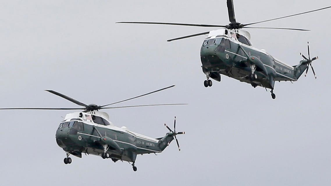 Two Sikorsky VH-3D Sea King helicopters with Marine Helicopter Squadron One (HMX-1) arrive at Miami International Airport for a presidential visit, Wednesday, April 22, 2015, in Miami. (AP)