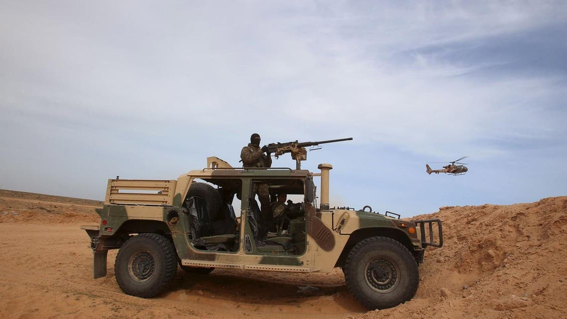 A Tunisian soldier holds his position during an exercise along the frontier with Libya in Sabkeht Alyun. (Reuters)