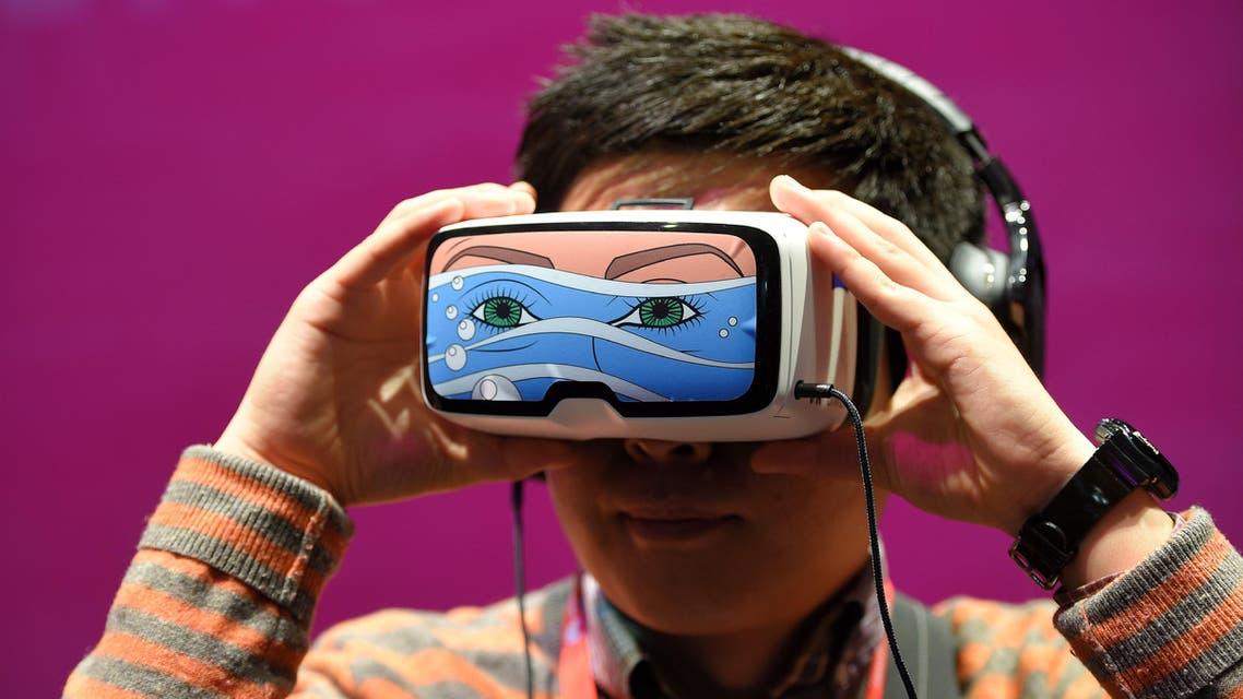 A boy tests the 'Oculus VR' virtual device, at the Deutsche Telekom stand. (AFP)