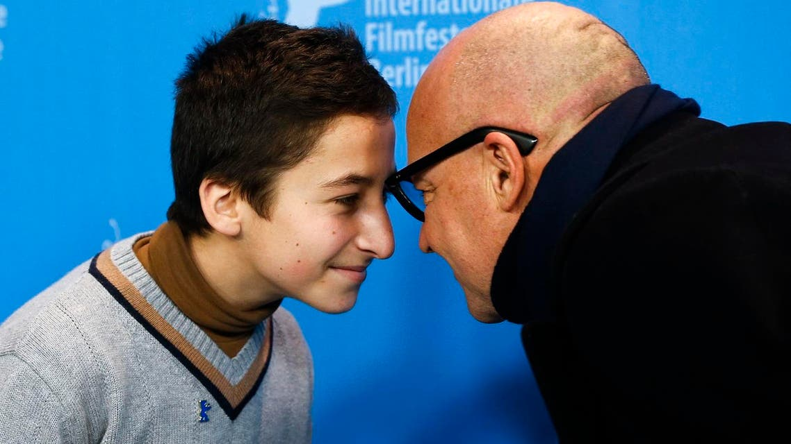 Protagonist Samuele Pucillu, left, and director Gianfranco Rosi pose for a photo during a photo call for the competition film 'Fire At Sea' at the 2016 Berlinale Film Festival in Berlin. (AP)