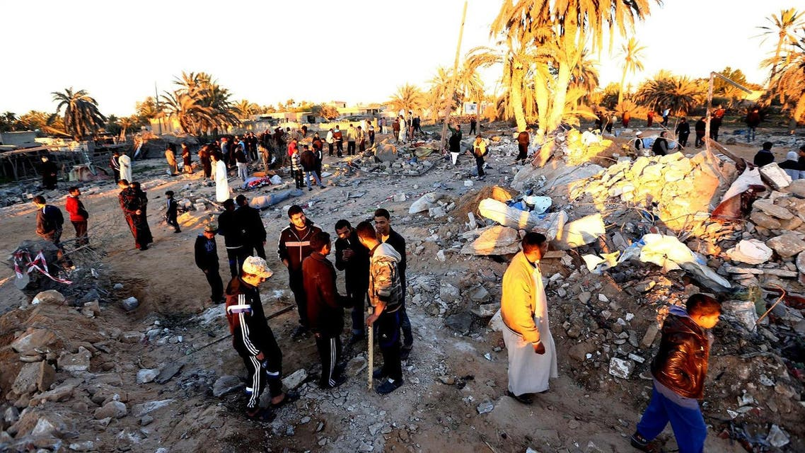 Libyans gather next to debris at the site of a jihadist training camp, targeted in a US air strike, near the Libyan city of Sabratha. (AFP)