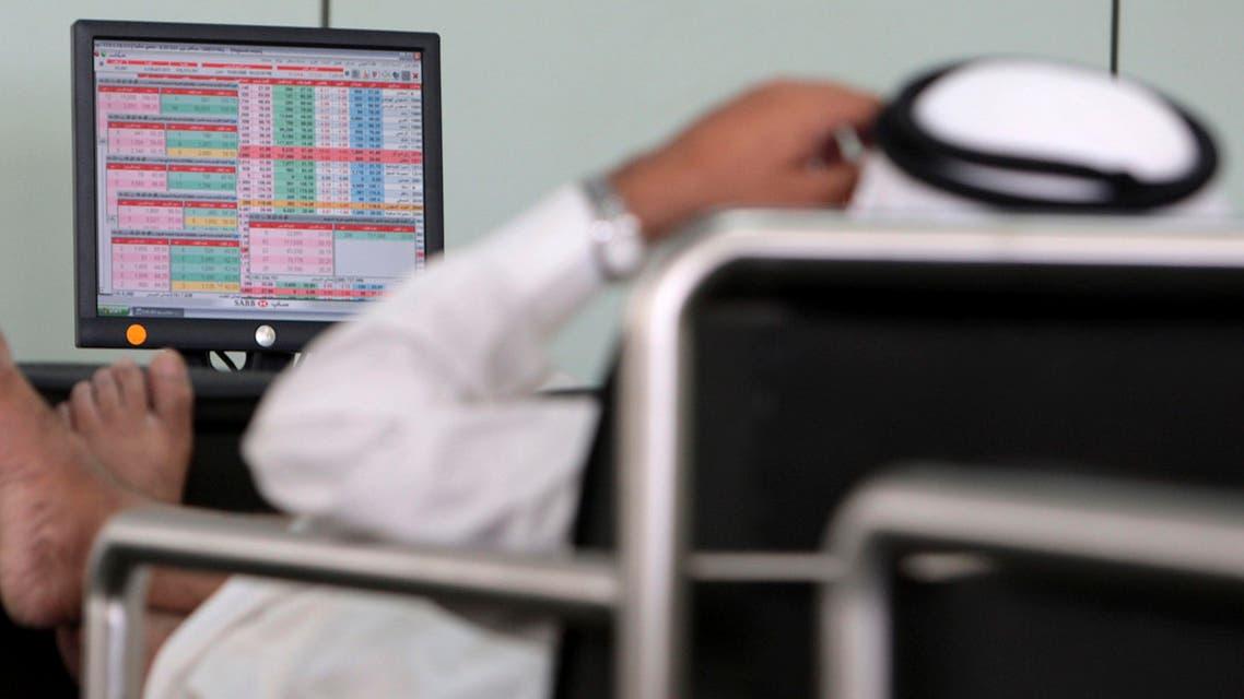 A trader works at a Saudi bank in Riyadh (Reuters)