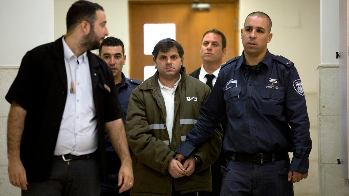 Yosef Haim Ben David, 31-year-old suspect, center, arrives for the reading of the verdict in the killing of Mohammed Abu Khdeir, 16, in the summer of 2014, at the Jerusalem District Court Monday, Nov. 30, 2015.