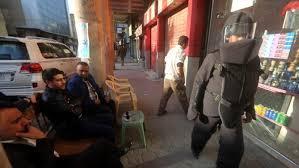 Iraqi artist Hussein Adil's bomb suit performance. (AFP)