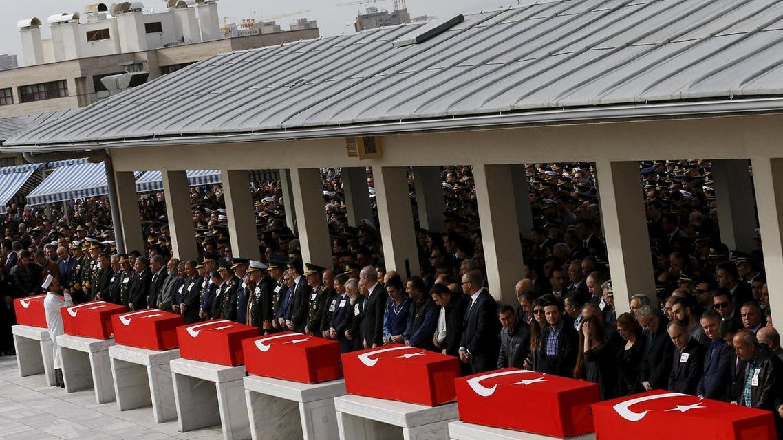 Turkish flag-draped coffins of the victims of Feb. 18's's car bombing, are placed at Kocatepe mosque during a funeral ceremony in Ankara