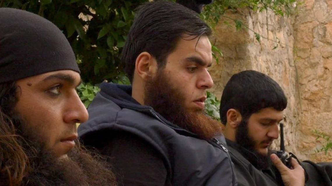 Abu Ali (L) and Abu Ljaman (C), both would-be suicide bombers for Al-Nusra Front in Syria, sit with a third man called Khattab in the Aleppo region during May 2015 (AFP Photo/Pal Refsdal)