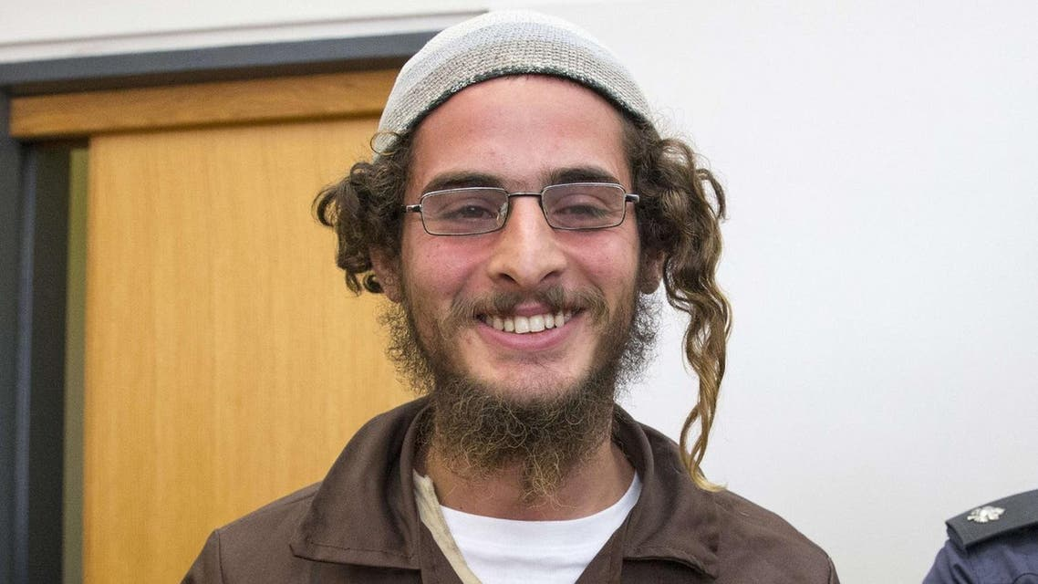 Meir Ettinger, the head of a Jewish extremist group, stands at the Israeli justice court in Nazareth Illit on August 4, 2015. (AFP)