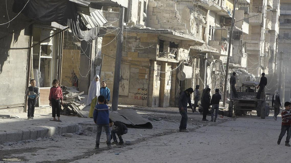 Residents inspect damage after an airstrike on the rebel held al-Fardous neighbourhood of Aleppo. (Reuters)