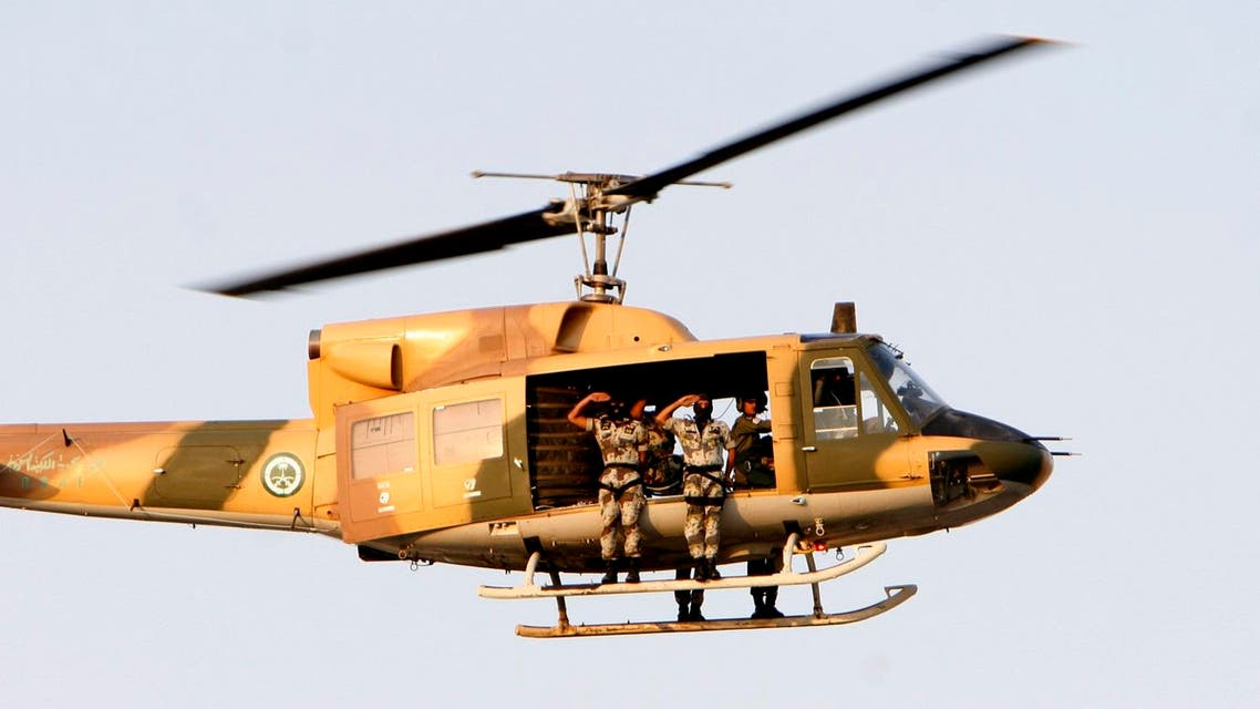 Saudi special forces parade as they fly with a military helicopter during a ceremony as they prepare for the Hajj three days before the event in Arafat 15 kms outside of Mecca, Saudi Arabia, Saturday, Dec. 15, 2007. (AP)
