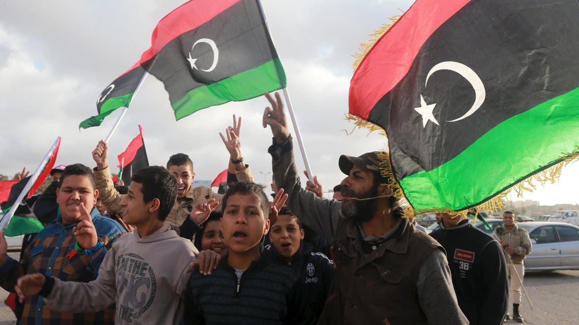 Libyans wave their national flags as they celebrate Libya's eastern government's gains in the area, in Benghazi, Libya, February 24, 2016. (Reuters)