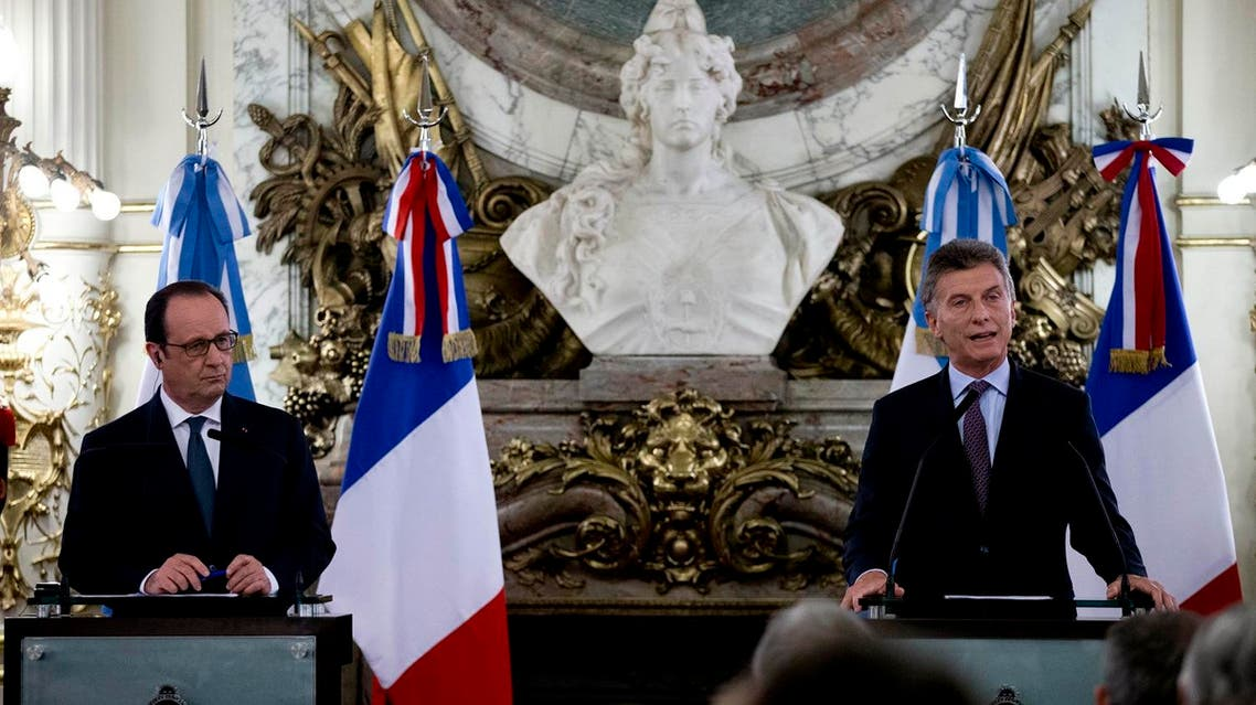 France's President Francois Hollande, left, and Argentina's President Mauricio Macri, attend a press conference at the government house in Buenos Aires, Argentina, Wednesday, Feb. 24, 2016. AP