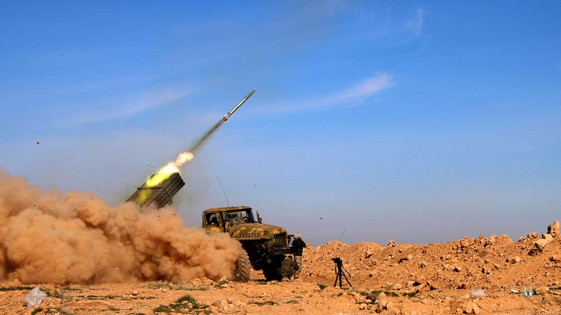 In this photo taken on Wednesday, Feb. 17, 2016, soldiers from the Syrian army fire a rocket at Islamic State group positions in the province of Raqqa, Syria. (AP)