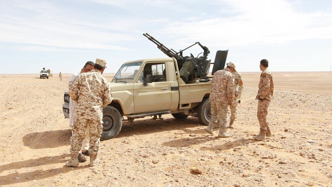 Libyan soldiers stand at a military outpost in Wadi Bey, west of the ISIS-held city of Sirte, February 23, 2016. (Reuters)