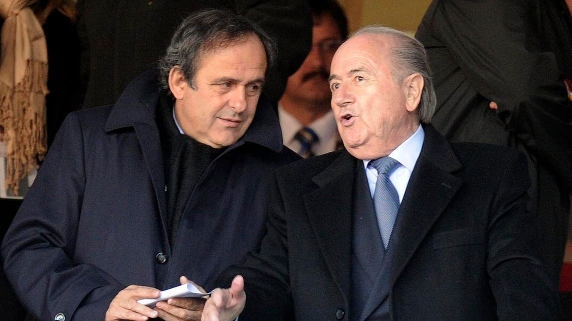 FIFA president Sepp Blatter, right, talks to UEFA president Michel Platini, left, during the World Cup group C soccer match between Slovenia and the United States at Ellis Park Stadium in Johannesburg, South Africa, Friday, June 18, 2010. (File Photo: AP)