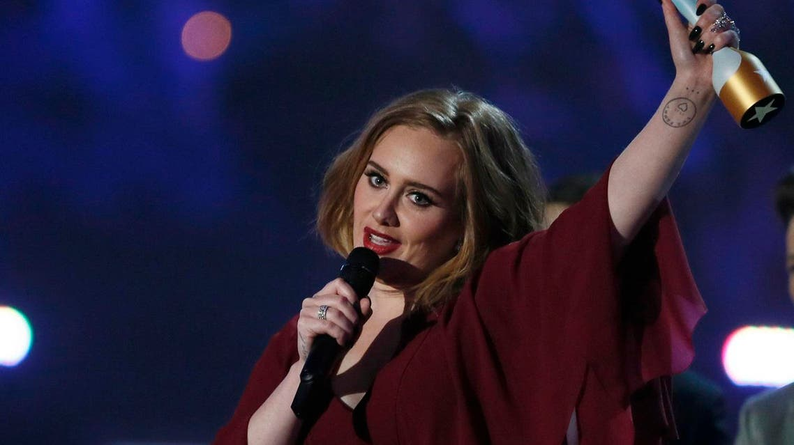 British singer and songwriter Adele accepts the award for best British female solo artist at the BRIT Awards at the O2 arena in London. (Reuters)