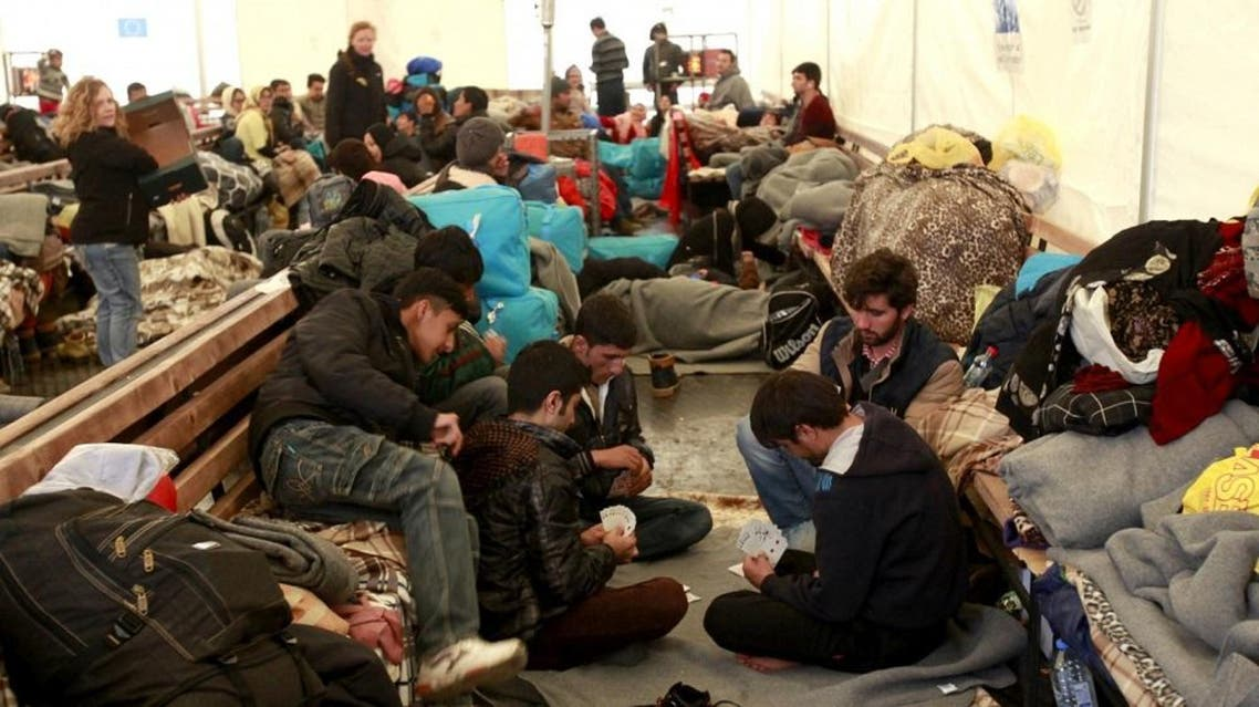 The plans involve using special centers to quickly process migrants who have little realistic chance of winning asylum (AP)