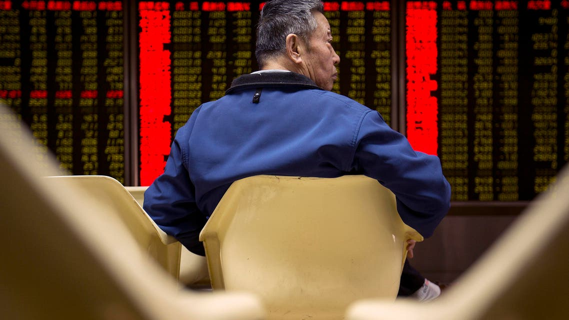 A Chinese investor monitors stock prices on an electronic display in a brokerage house in Beijing, Thursday, Feb. 25, 2016.  (AP)