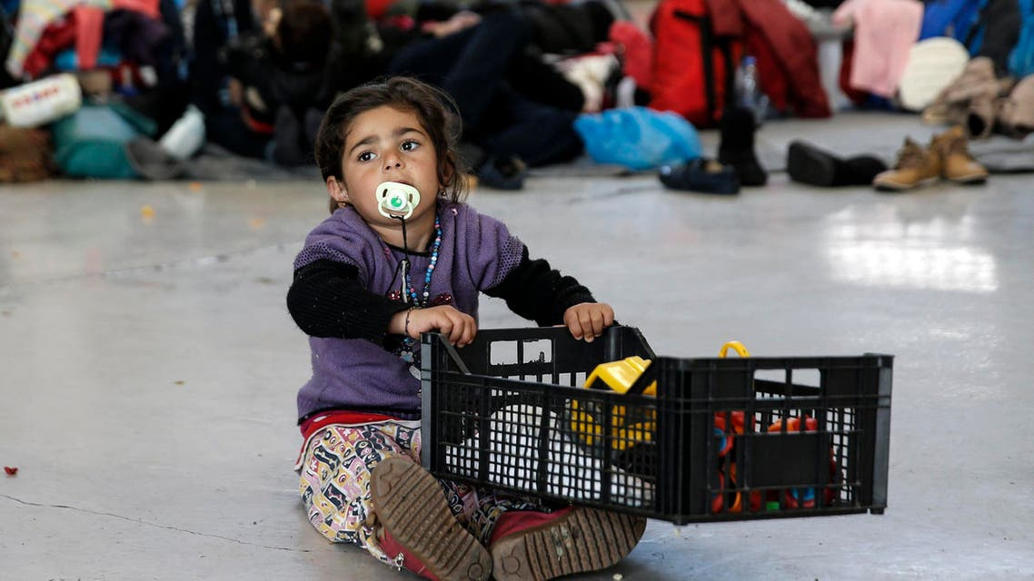 A girl carries her toys inside a plastic crate, at a passenger terminal where stranded refugees and migrants find shelter at the port of Piraeus, near Athens, Greece, February 25, 2016.  (Reuters)