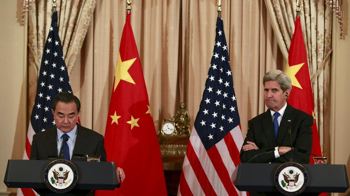 U.S. Secretary of State John Kerry (R) and Chinese Foreign Minister Wang Yi hold a joint news conference after their meeting at the State Department in Washington, February 23, 2016. REUTERS
