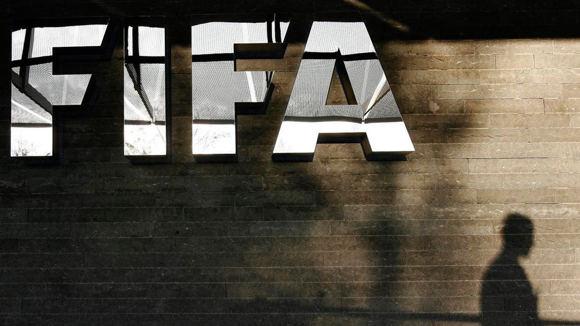 The FIFA logo at the FIFA headquarter in Zurich, Switzerland, Monday, Oct. 29, 2007. FIFA will formally announce Tuesday, October 30, the location for the women's World Cup 2011 and the men's Wold Cup 2014. AP