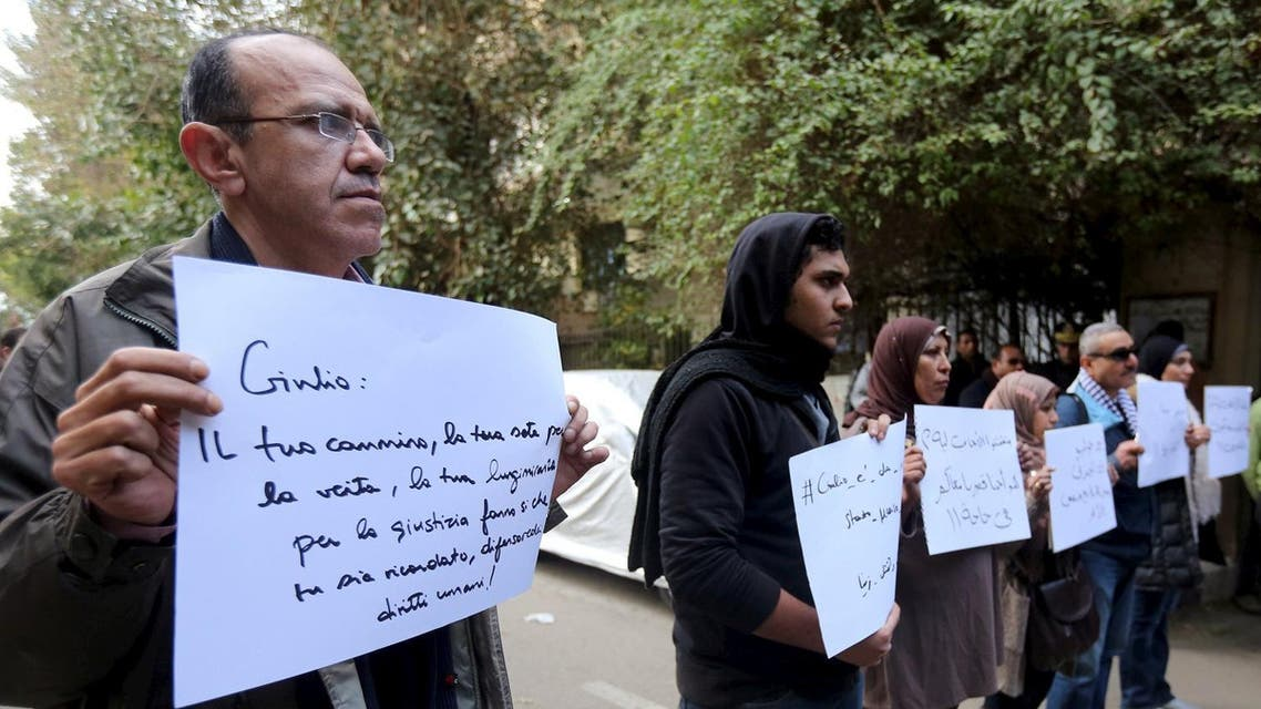 Activists hold placards during a memorial for Giulio Regeni outside of the Italian embassy in Cairo. (Reuters)