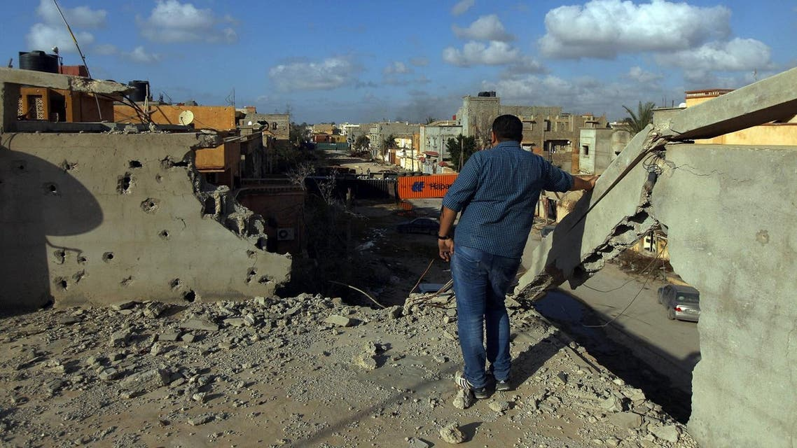 A man stands on a roof of a building after fighters loyal to Libya's internationally recognized government seized the centre of the eastern coastal city of Benghazi. (AFP)