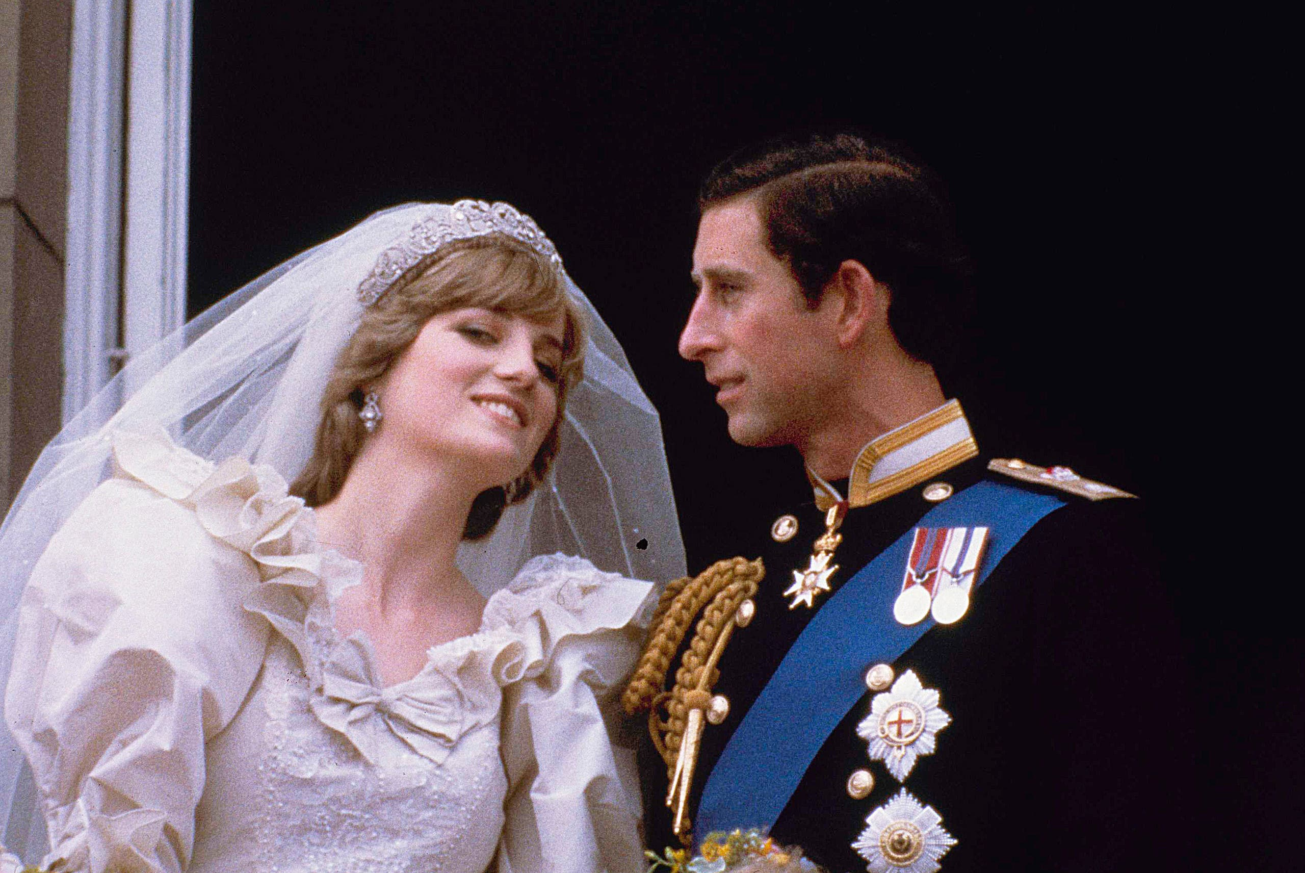 Prince Charles and his bride Diana, Princess of Wales, are shown on their wedding day on the balcony of Buckingham Palace in London, July 29, 1981.  (AP)