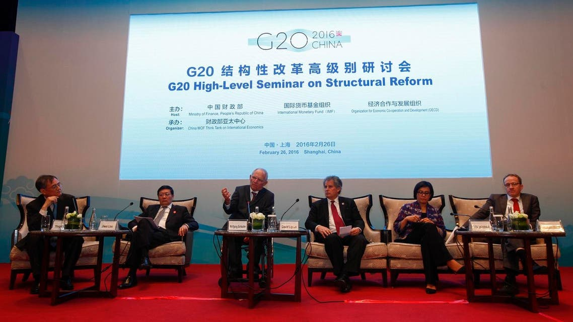 Participants from left to right, Moderator Yingyi Qian, Chinese Finance Minister Lou Jiwei, German Finance Minister Wolfgang Schaeuble, International Monetary Fund (IMF) First Deputy Director David Lipton, World Bank Managing Director Sri Mulyani Indrawati and Breugel Director Guntram Wolff compose a panel during a session of the G20 High-Level Seminar on Structural Reform. AP