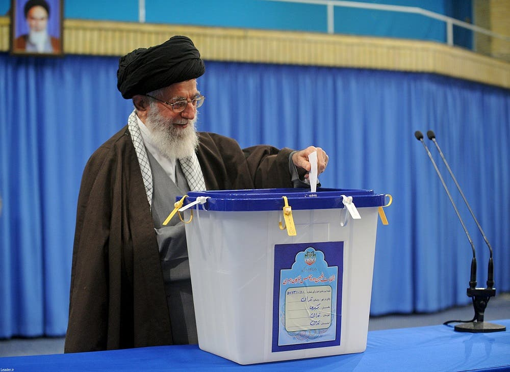 Iran's Supreme Leader Ayatollah Ali Khamenei casts his vote during elections for the parliament and Assembly of Experts, in Tehran. (Reuters)