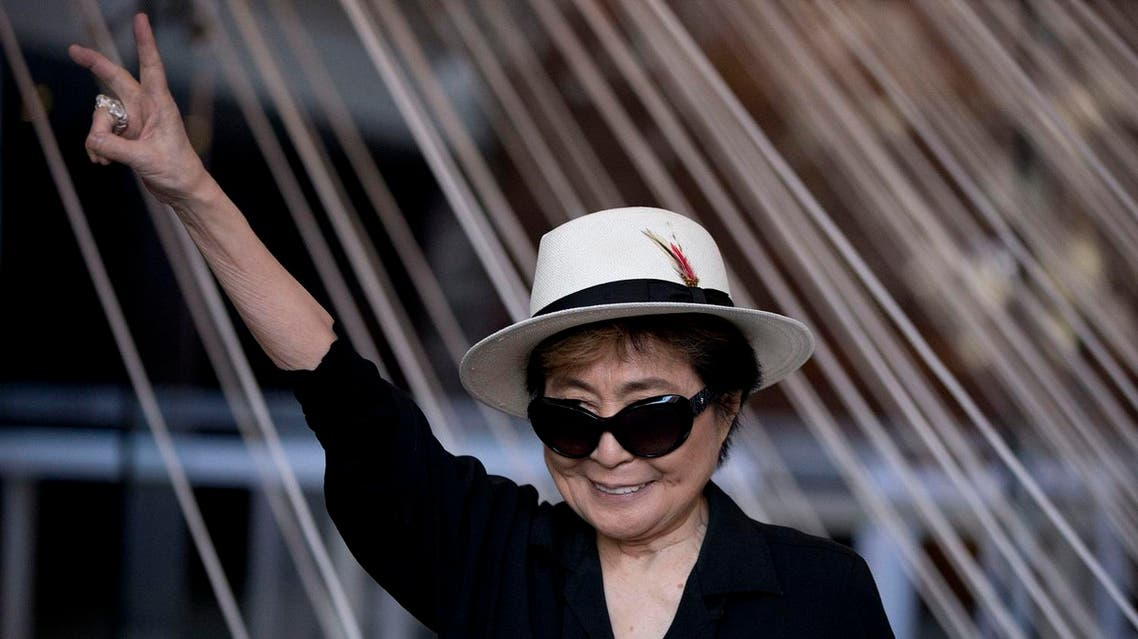 """Yoko Ono poses for photographers in front of a work entitled """"Morning Beams/River Bed,"""" at a press event to mark the opening of her exhibiition """"Land of Hope"""" at the Museum of Memory and Tolerance in Mexico City, Tuesday, Feb. 2, 2016. AP"""