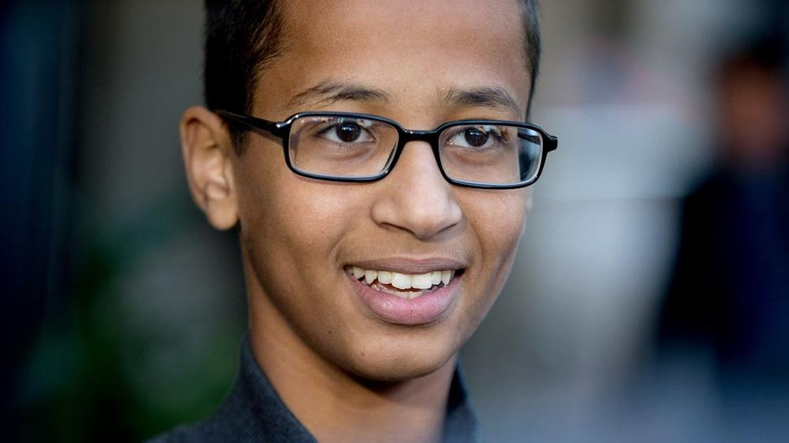 In this Monday, Oct. 19, 2015, file photo, Ahmed Mohamed, the 14-year-old who was arrested at MacArthur High School in Irving, Texas, after a homemade clock he brought to school was mistaken for a bomb, speaks during an interview with the Associated Press, in Washington. Mohamed of Irving and his family are preparing to move to the Middle East. He's accepted a foundation's offer to pay for high school and college in Qatar (AP Photo/Andrew Harnik, File)