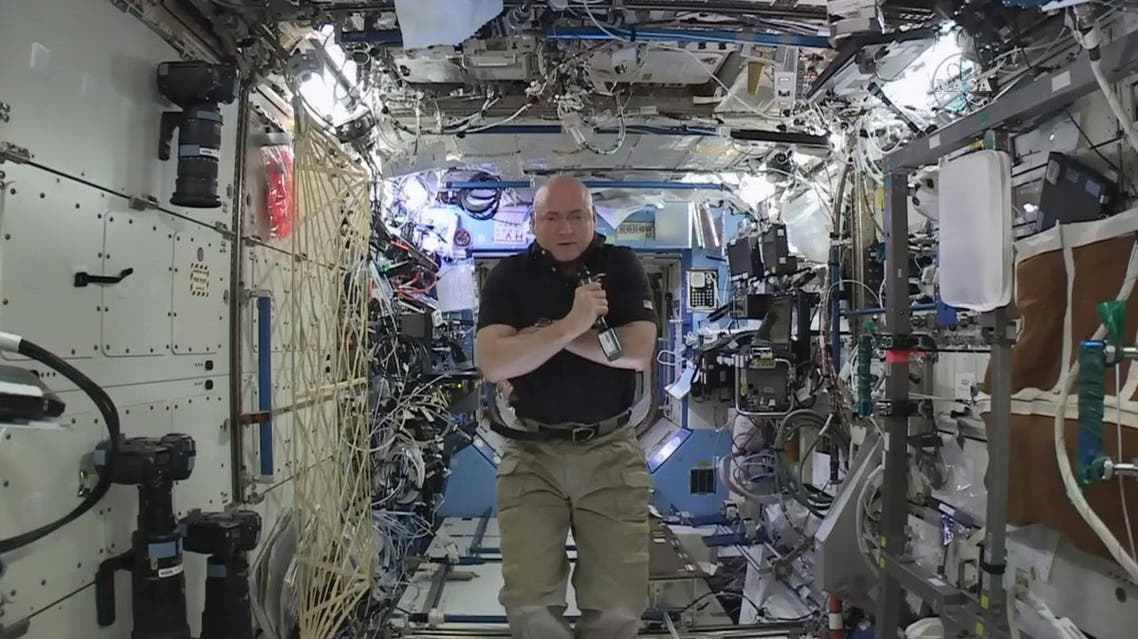 In this image from video made available by NASA, astronaut Scott Kelly speaks to reporters on Earth during a news conference held on the International Space Station on Thursday, Feb. 25, 2016. (AP)