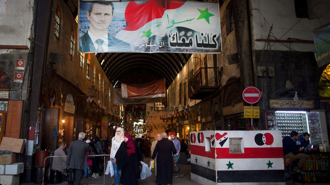 In this Wednesday, Feb. 24, 2016 file photo, a poster of Syrian President Bashar Assad hangs at the popular Souk Tawil old market in Damascus, Syria.  (AP)