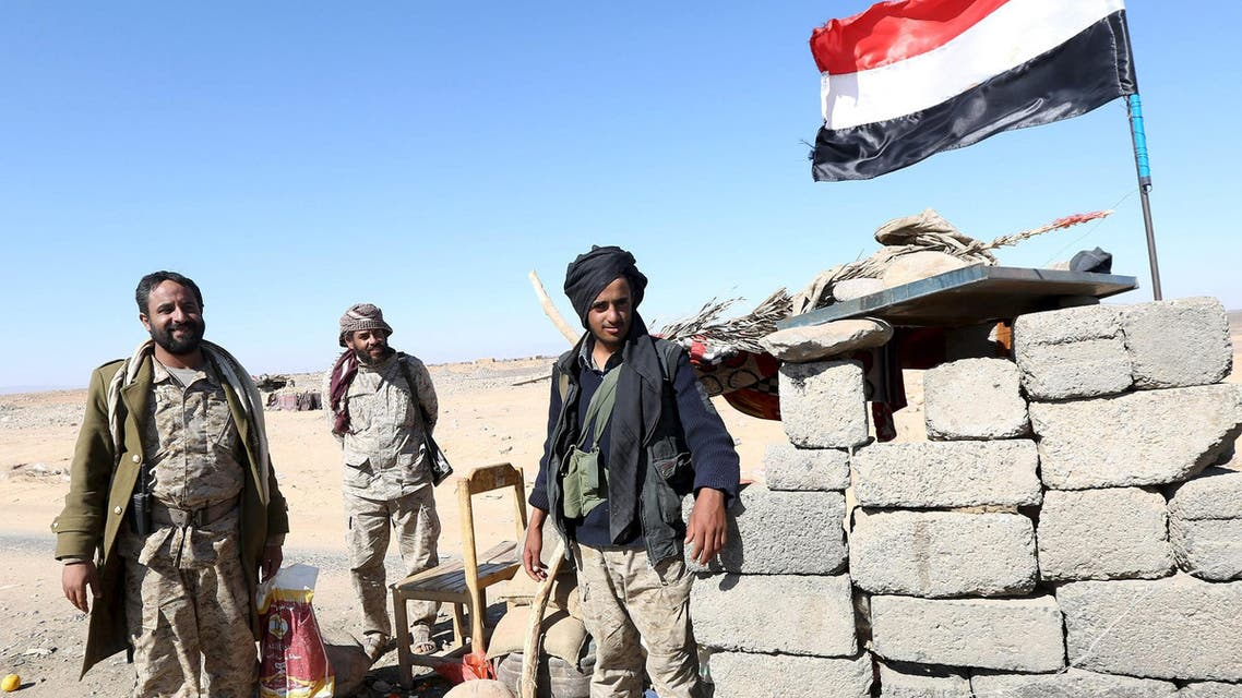 Pro-government army soldiers man a checkpoint on a road in Fardhat Nahm area, which has recently been taken by the army from Houthi rebels, around 60km (40 miles) from Yemen's capital Sanaa, February 20, 2016. (Reuters)