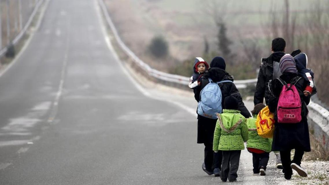 Stranded Afghan migrants make their way towards the Greek-Macedonian border near the Greek village of Idomeni, February 24, 2016 (Reuters)