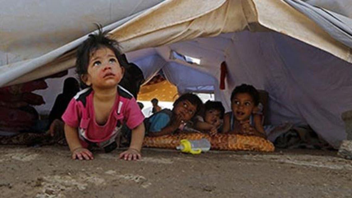 أطفال عراقيون  في مخيمات الاجئين - أرشيفية