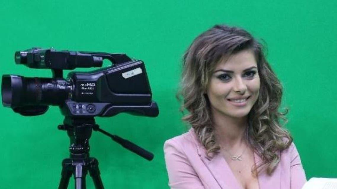 Presenter Greta Hoxhaj, 24, poses prior appearing on a news programme on Zjarr TV (Fire TV) in Tirana (AFP Photo/Gent Shkullaku)