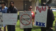 Three stabbed and 13 arrested at KKK rally in California