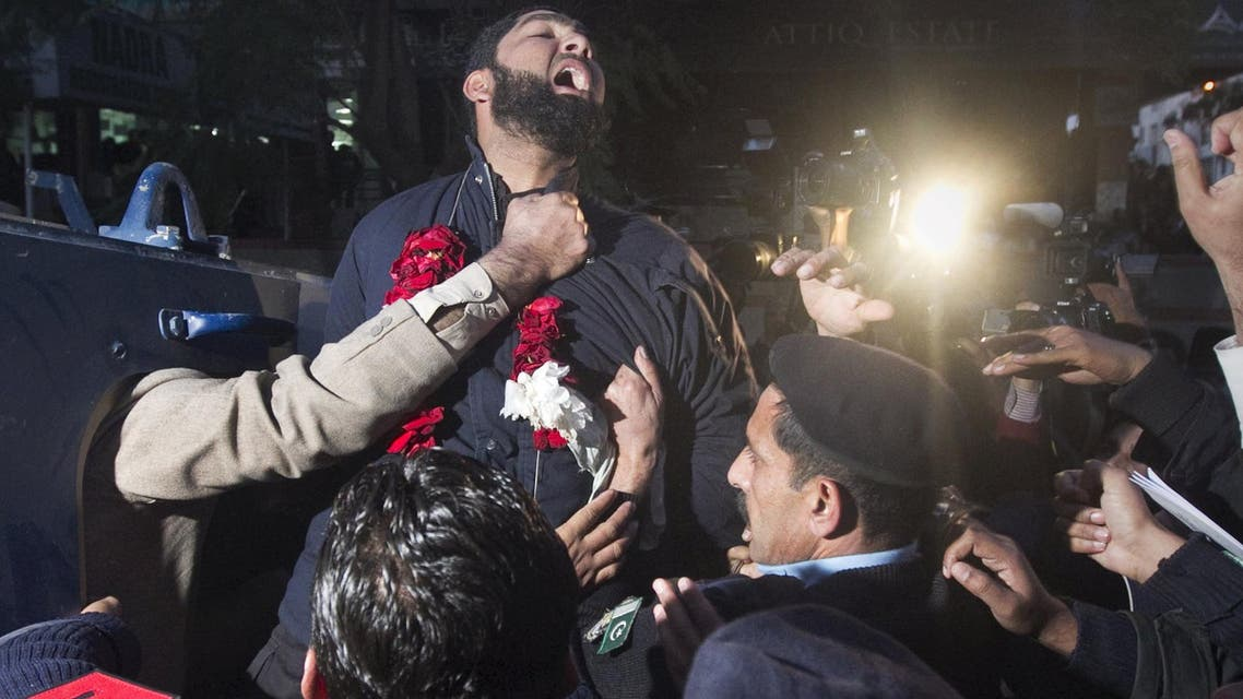 Malik Mumtaz Hussain Qadri, the bodyguard arrested for the killing of Punjab Governor Salman Taseer, shouts religious slogans while being taken away by the police after he was presented at a court in Islamabad, in this January 5, 2011 file picture. (Reuters)