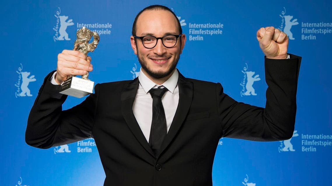 Majd Mastoura poses with the Silver Bear award for Best Actor during the awards ceremony of the 66th Berlinale International Film Festival in Berlin, Germany February 20, 2016. REUTERS