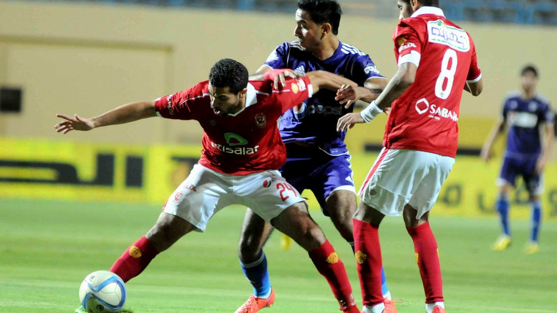 Al Ahly's Ahmed Fathy, left, tries to keep the ball against Zamalek's Mahmoud Kahraba, center, during their Egyptian Cup soccer match at the Petrosport Stadium in Cairo, Egypt, Monday, Sept. 21, 2015. (AP)