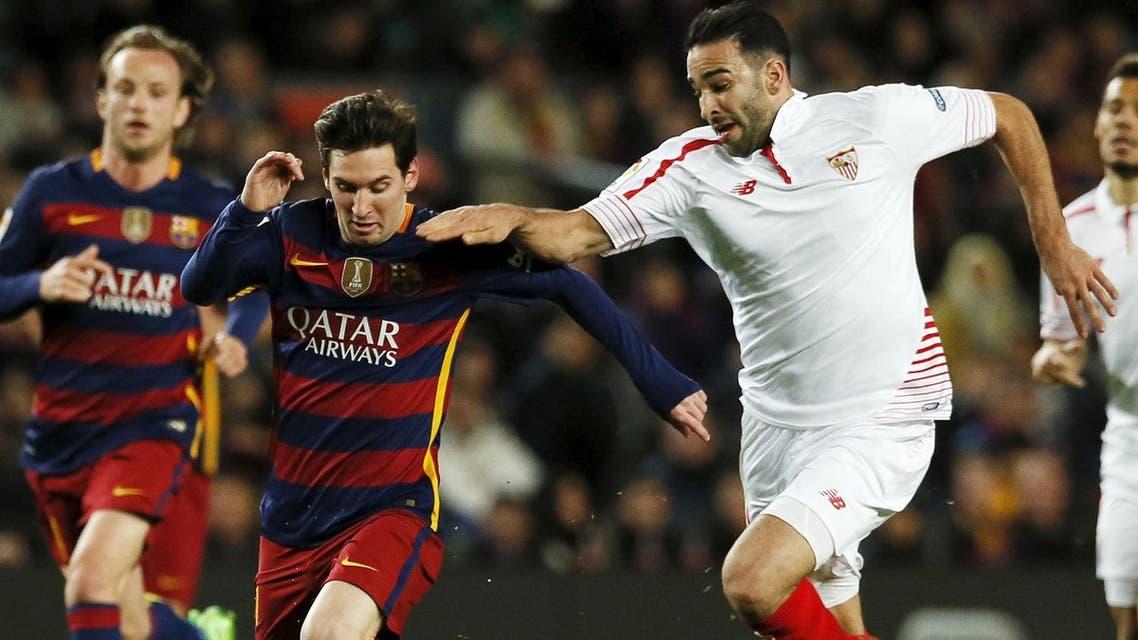 Football Soccer - Barcelona v Sevilla - Spanish Liga BBVA - Camp Nou stadium, Barcelona - 28/2/16Barcelona's Lionel Messi fights for the ball against Sevilla's Adil Rami. REUTERS
