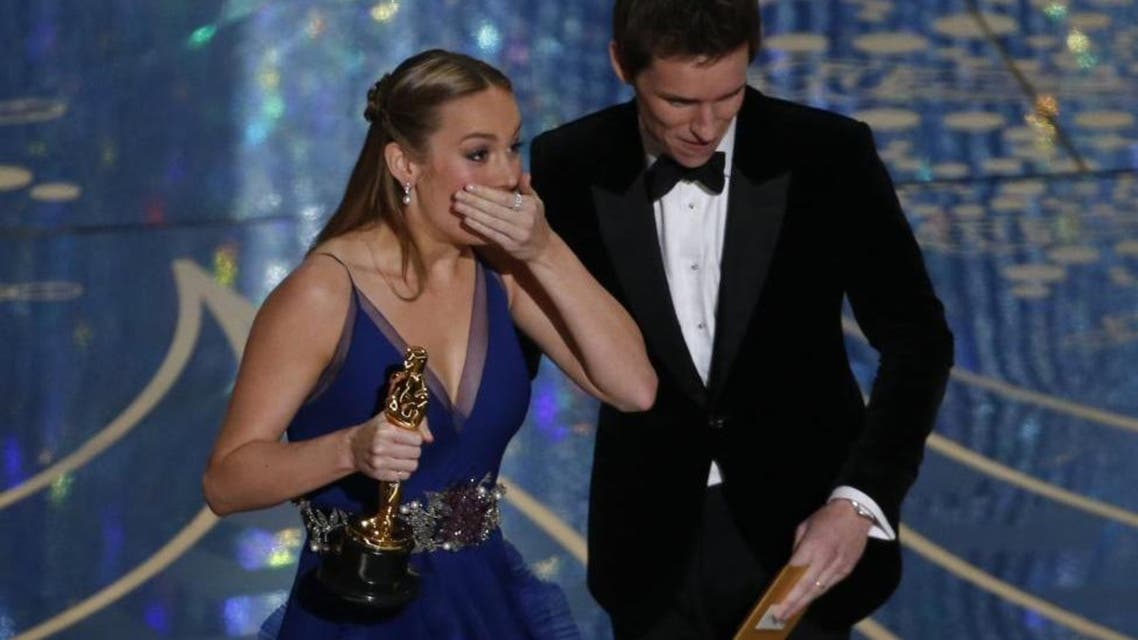 """Brie Larson reacts as she takes the stage to accepts the Oscar for Best Actress for her role in """"Room"""" from presenter Eddie Redmayne."""