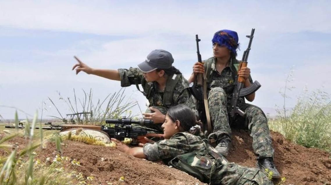 Kurdish female fighters of the Women Protection Unit (YPJ) attend military training near Qamishli city May 11, 2014. REUTERS