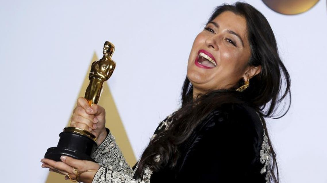 "Pakistani journalist and filmmaker Sharmeen Obaid-Chinoy, winner of Best Documentary Short Subject Film for ""A Girl in the River: The Price of Forgiveness"", poses. (Reuters)"